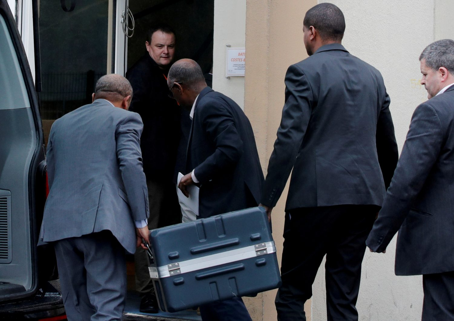 Men unload a case containing the black boxes from the crashed Ethiopian Airlines Boeing 737 MAX 8 outside the headquarters of France's BEA air accident investigation agency in Le Bourget, north of Paris, France, March 14, 2019. REUTERS/Philippe Wojazer/File Photo