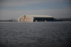 FILE PHOTO: One of many areas near the southeast side of Offutt Air Force Base affected by flood waters is seen in Nebraska, U.S., March 16, 2019. Courtesy Rachelle Blake/U.S. Air Force/Handout via REUTERS