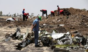 FILE PHOTO: A man watches debris at the scene of the Ethiopian Airlines Flight ET 302 plane crash, near the town of Bishoftu, southeast of Addis Ababa, Ethiopia March 12, 2019. REUTERS/Baz Ratner