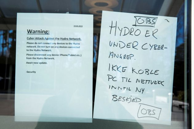 A note warning visitors about a cyber attack is seen at the headquarters of aluminum producer Norsk Hydro in Oslo, Norway March 19, 2019. NTB Scanpix/Terje Pedersen via REUTERS
