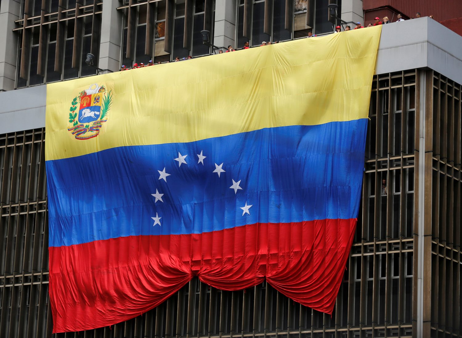 FILE PHOTO: A Venezuelan flag hangs from a building in Caracas March 11, 2013. REUTERS/Tomas Bravo/File Photo