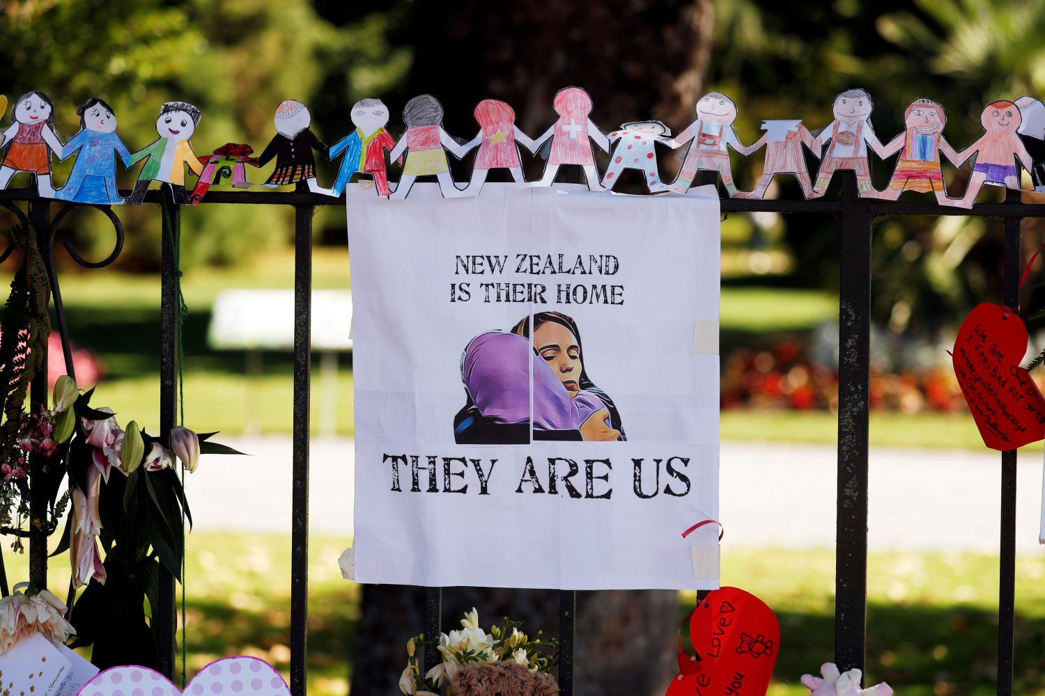 A poster hangs at a memorial site for victims of Friday's shooting, in front of Christchurch Botanic Gardens in Christchurch, New Zealand March 19, 2019. REUTERS/Jorge Silva