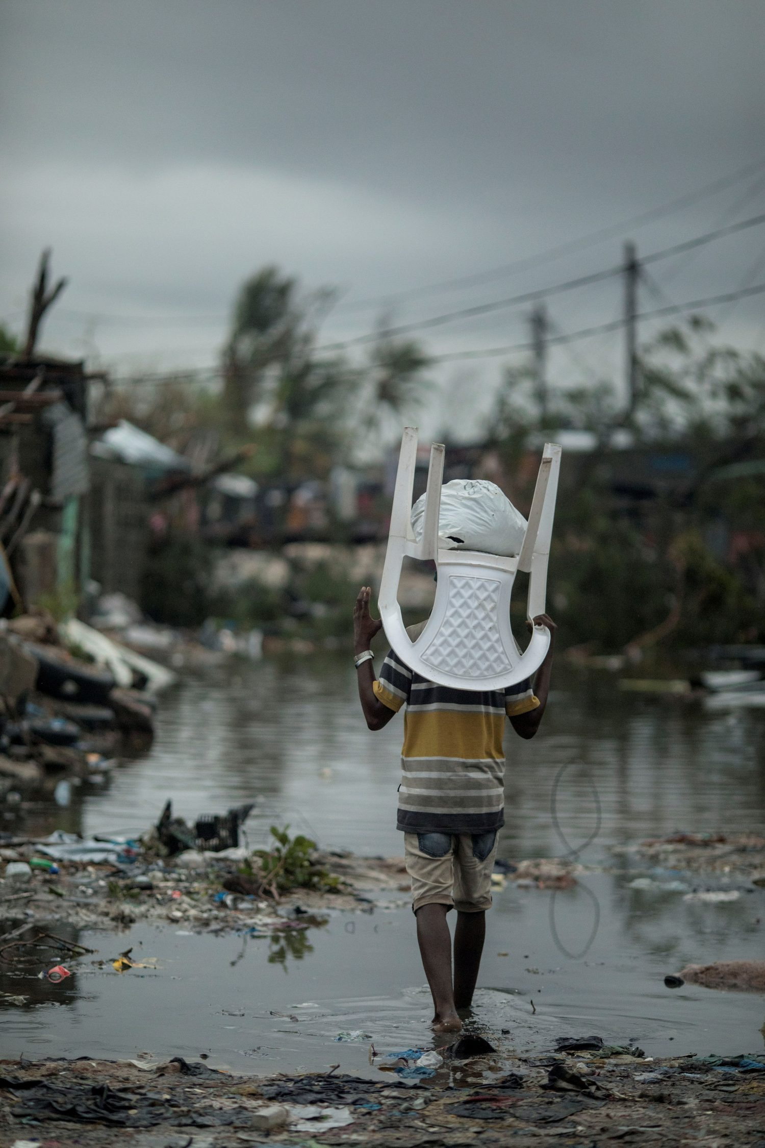 People return to Praia Nova Village neighborhood following Cyclone Idai in Beira, Mozambique, March 17, 2019. Josh Estey/Care International via REUTERS