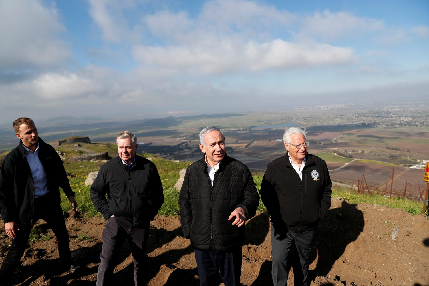 FILE PHOTO: Israeli Prime Minister Benjamin Netanyahu, U.S. Republican Senator Lindsey Graham and U.S. Ambassador to Israel David Friedman visit the border between Israel and Syria in the Israeli-occupied Golan Heights, March 11, 2019 REUTERS/Ronen Zvulun/File Photo