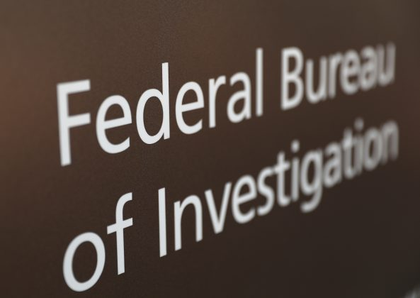 FILE PHOTO: A sign of the Federal Bureau of Investigation is seen outside of the J. Edgar Hoover FBI Building in Washington, U.S., March 12, 2019. REUTERS/Leah Millis