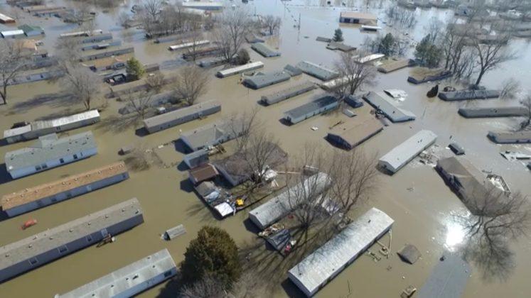 Buildings are submereged in floodwater in Bellevue, Nebraska, U.S., March 20, 2019, in this still imgage taken from social media. Bellevue (Nebraska) Police Department via REUTERS