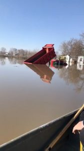A truck is submereged in floodwater in Bellevue, Nebraska, U.S., March 21, 2019, in this still imgage taken from social media. Bellevue (Nebraska) Police Department via REUTERS