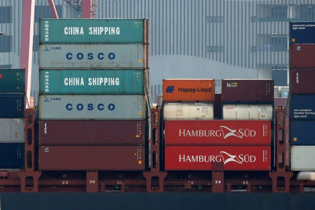 FILE PHOTO: Shipping containers of China Shipping and China Ocean Shipping Company (COSCO) are seen on a container ship at Kwai Tsing Container Terminals in Hong Kong, China July 25, 2018. REUTERS/Bobby Yip/File Photo