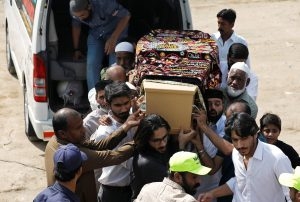 Relatives and neighbours carry the coffin of Syed Areeb Ahmed, who was killed in Christchurch mosque attack in New Zealand, during a funeral in Karachi, Pakistan, March 25, 2019. REUTERS/Akhtar Soomro