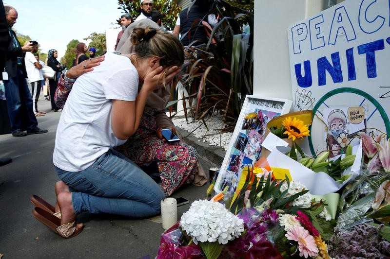 FILE PHOTO: A woman reacts at a make shift memorial outside the Al-Noor mosque in Christchurch, New Zealand March 23, 2019. REUTERS/Edgar Su