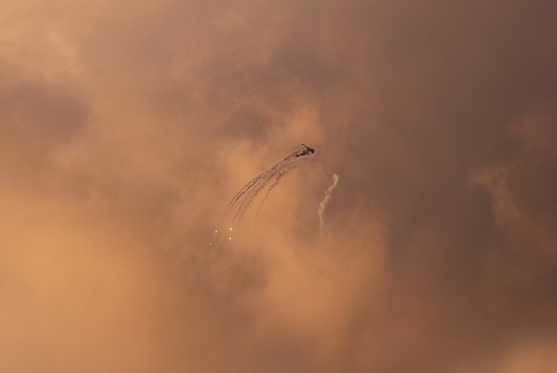 An Israeli Apache helicopter releases flares as it flies over the Gaza Strip March 25, 2019. REUTERS/Mohammed Salem