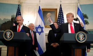 U.S. President Donald Trump gestures next to Israel's Prime Minister Benjamin Netanyahu during a ceremony to sign a proclamation recognizing Israel's sovereignty over the Golan Heights in the Diplomatic Reception Room at the White House in Washington, U.S., March 25, 2019. REUTERS/Carlos Barria
