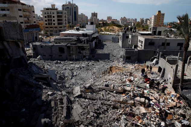 Palestinians inspect a destroyed Hamas site after it was targeted in an Israeli air strike in Gaza City March 26, 2019. REUTERS/Mohammed Salem