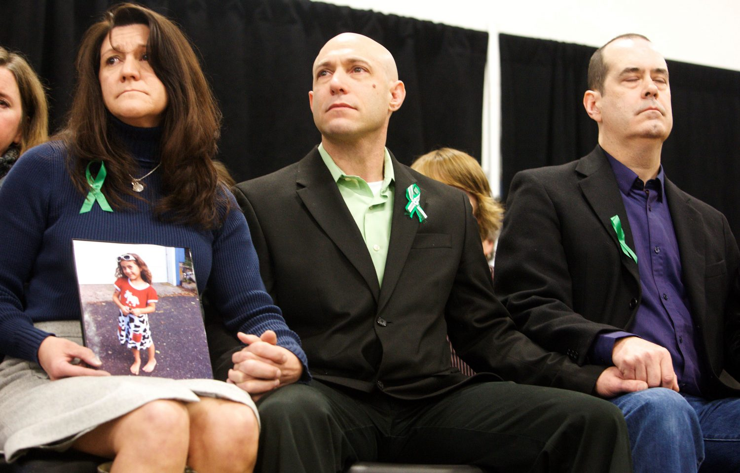 FILE PHOTO: Jennifer Hensel (L) and Jeremy Richman, the parents of Avielle Richman, 6, and David Wheeler (R), the father of Benjamin Wheeler, 6, victims of the December 14, 2012 shooting at Sandy Hook Elementary School, attend the launch of The Sandy Hook Promise, a non-profit created in response to the shooting in Newtown, Connecticut January 14, 2013. REUTERS/Michelle McLoughlin/File Photo