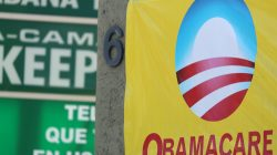 FILE PHOTO - A sign on an insurance store advertises Obamacare in San Ysidro, San Diego, California, U.S., October 26, 2017. REUTERS/Mike Blake
