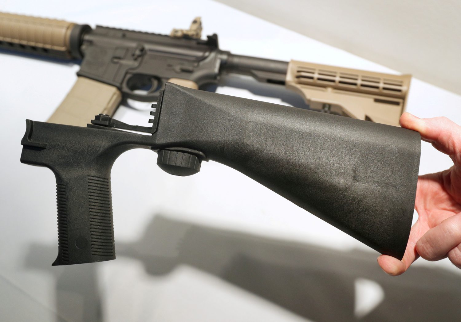 FILE PHOTO: A bump fire stock that attaches to a semi-automatic rifle to increase the firing rate is seen at Good Guys Gun Shop in Orem, Utah, U.S., October 4, 2017. REUTERS/George Frey/File Photo
