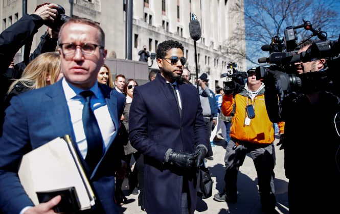 Actor Jussie Smollett leaves court after charges against him were dropped by state prosecutors in Chicago, Illinois, U.S. March 26, 2019. REUTERS/Kamil Krzaczynski