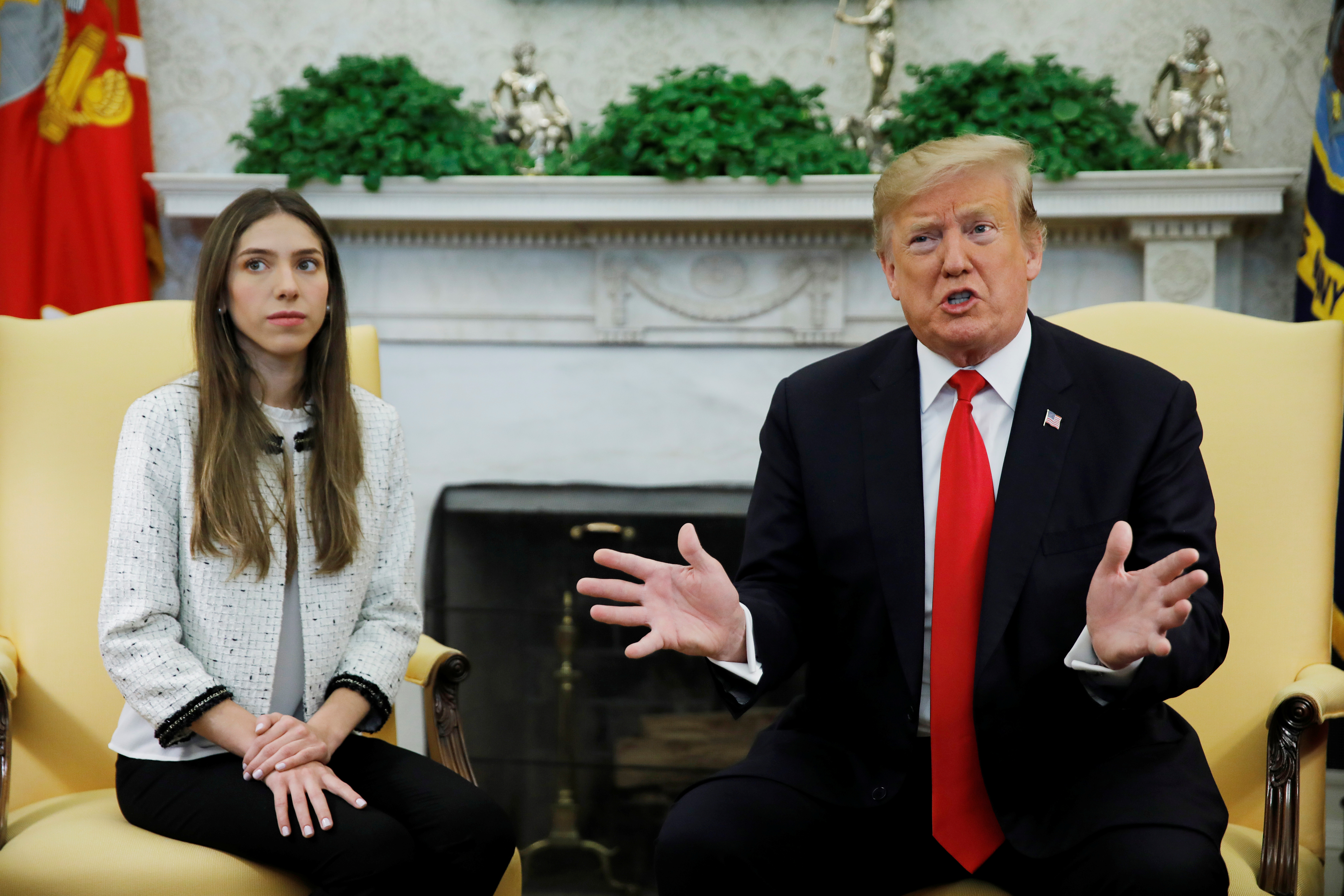 U.S. President Donald Trump meets with Fabiana Rosales, wife of Venezuelan opposition leader Juan Guaido, in the Oval Office at the White House in Washington, U.S., March 27, 2019. REUTERS/Carlos Barria