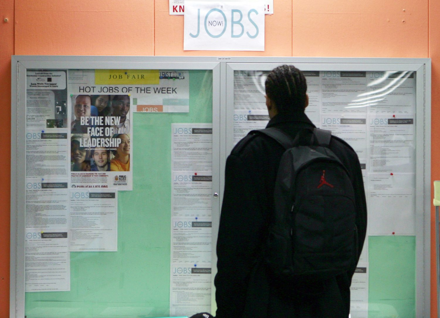 FILE PHOTO: A man looks over employment opportunities at a jobs center in San Francisco, California, in this February 4, 2010 file photo. REUTERS/Robert Galbraith/Files