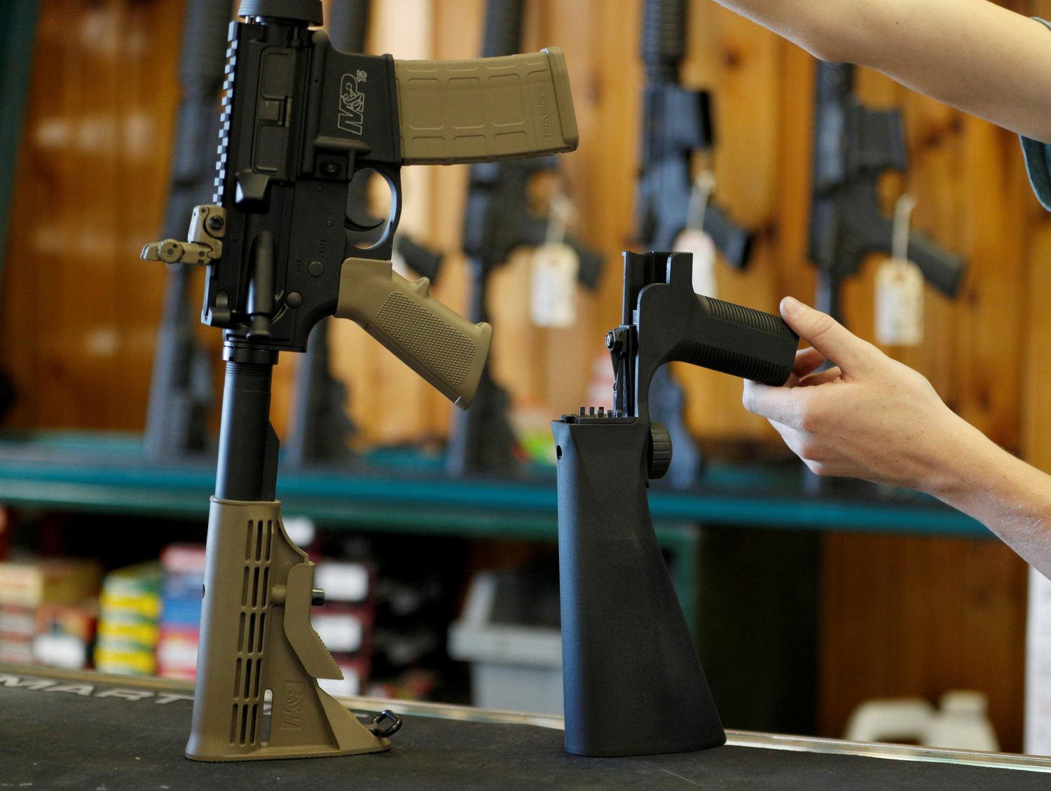 FILE PHOTO: A bump fire stock, (R), that attaches to a semi-automatic rifle to increase the firing rate is seen at Good Guys Gun Shop in Orem, Utah, U.S., October 4, 2017. REUTERS/George Frey/File Photo