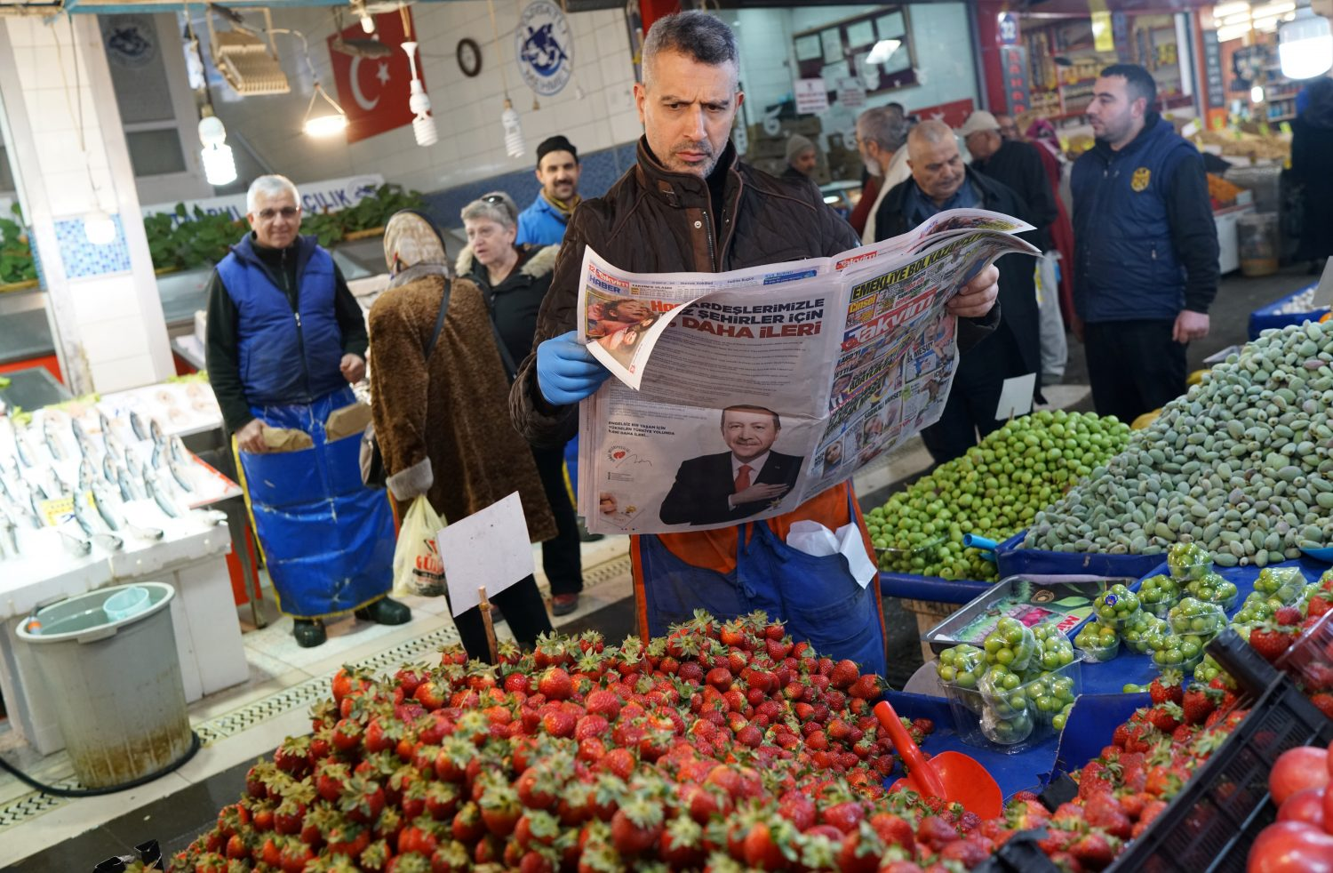 A stallholder reads a newspaper as he waits for customers at a bazaar in Ankara, Turkey, March 26, 2019. Picture taken March 26, 2019. REUTERS/Umit Bektas