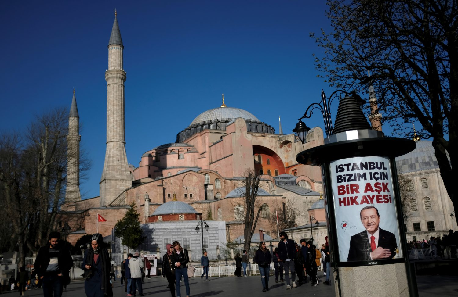 An election banner of Turkish President Tayyip Erdogan, with the Byzantine-era monument of Hagia Sophia in the background, is pictured in Istanbul, Turkey, March 28, 2019. REUTERS/Murad Sezer