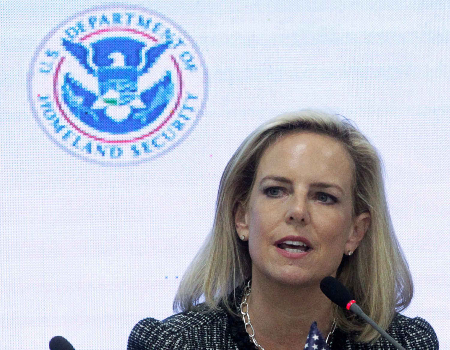 FILE PHOTO: U.S. Secretary of Homeland Security Kirstjen Nielsen speaks beside Honduras' President Juan Orlando Hernandez (not pictured) during a multilateral meeting at the Honduran Ministry of Security in Tegucigalpa, Honduras, March 27, 2019. REUTERS/Jorge Cabrera/File Photo