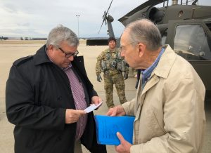 U.S. Senator Charles Grassley of Iowa and USDA Under Secretary Bill Northey speak before boarding a helicopter to view flood damage, in Omaha, Nebraska, U.S., March 29, 2019. Photo taken March 29, 2019. REUTERS/Tom Polansek
