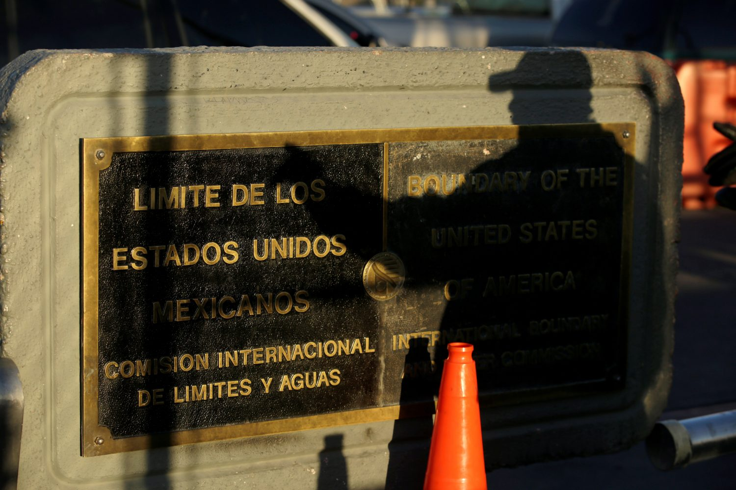 A U.S. Customs and Border Protection (CBP) agent cast his shadow on a plaque marking the boundaries of Mexico and United States, at Paso del Norte international border crossing bridge, in Ciudad Juarez, Mexico April 1, 2019. REUTERS/Jose Luis Gonzalez