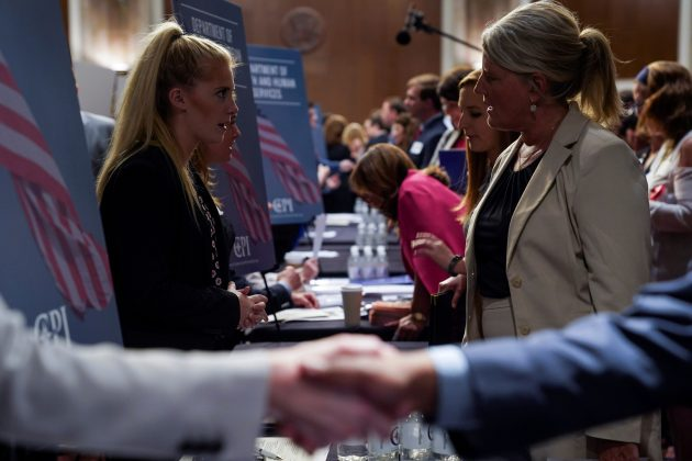 FILE PHOTO - People attend the Executive Branch Job Fair hosted by the Conservative Partnership Institute at the Dirksen Senate Office Building in Washington, U.S., June 15, 2018. REUTERS/Toya Sarno Jordan/File Photo