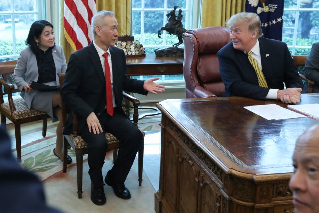 U.S. President Donald Trump talks with with China's Vice Premier Liu He in the Oval Office of the White House in Washington, U.S., April 4, 2019. REUTERS/Jonathan Ernst