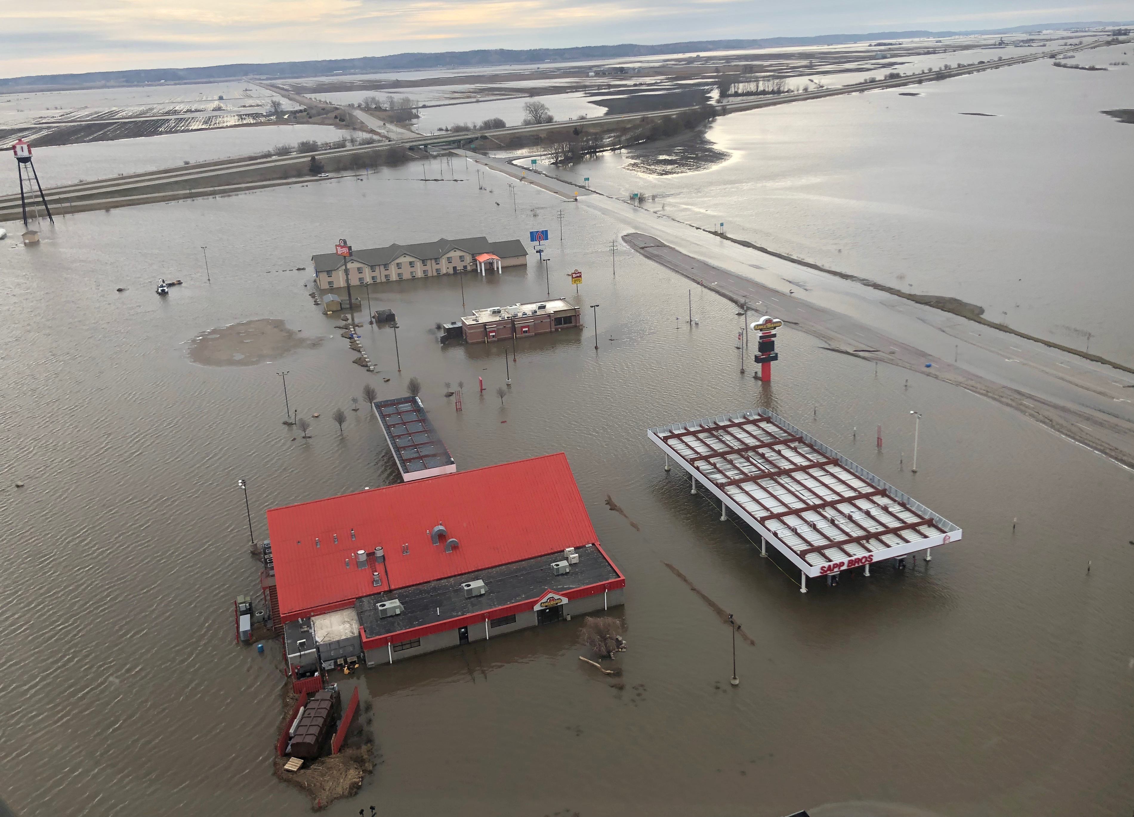 FILE PHOTO: A motel, restaurant and travel stop are shown surrounded by flood waters in this aerial photo in Percival, Iowa, U.S., March 29, 2019. REUTERS/Tom Polansek/File Photo
