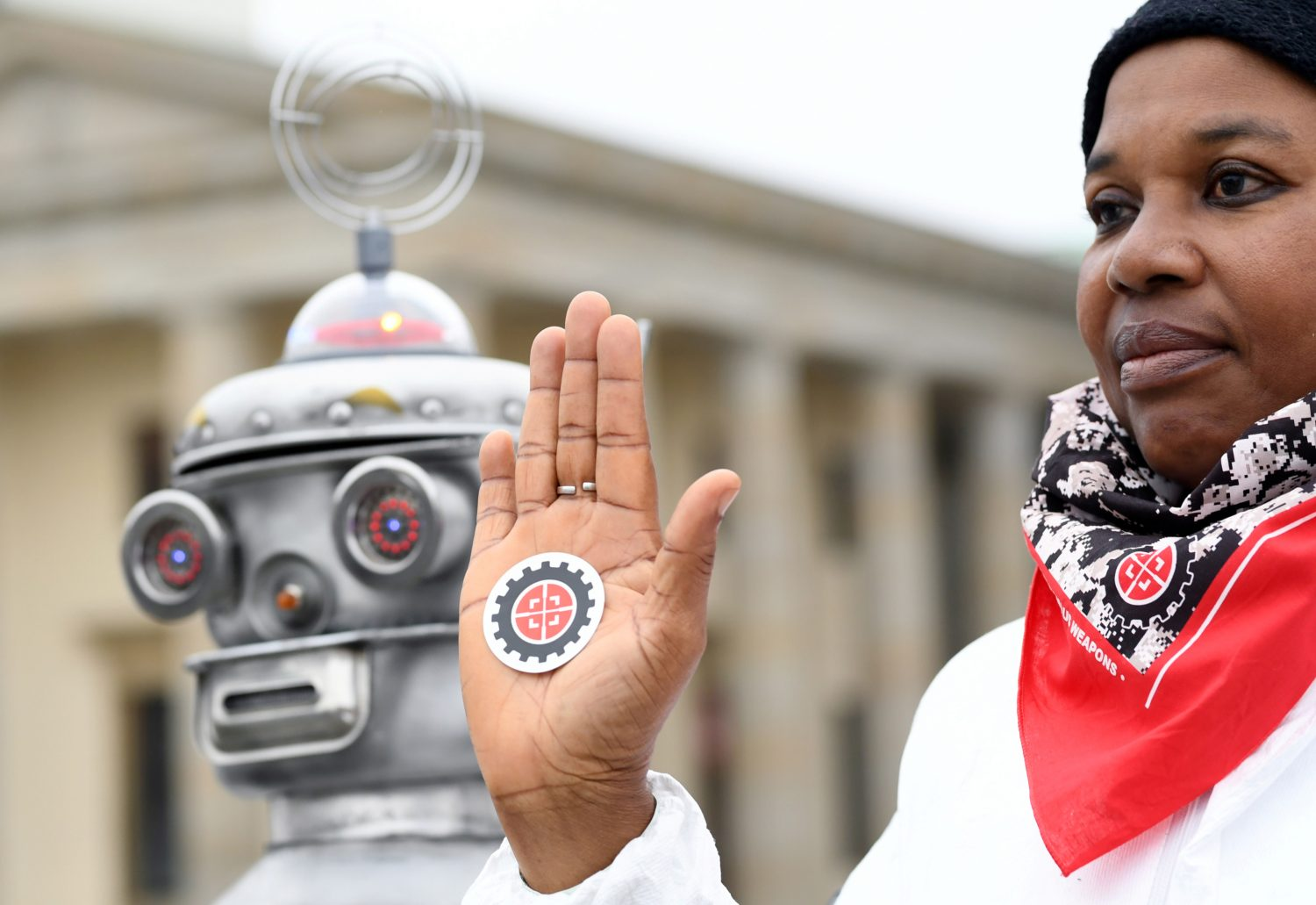 FILE PHOTO: An activist from the Campaign to Stop Killer Robots, a coalition of non-governmental organisations opposing lethal autonomous weapons or so-called 'killer robots', protests at Brandenburg Gate in Berlin, Germany, March, 21, 2019. REUTERS/Annegret Hilse/File Photo