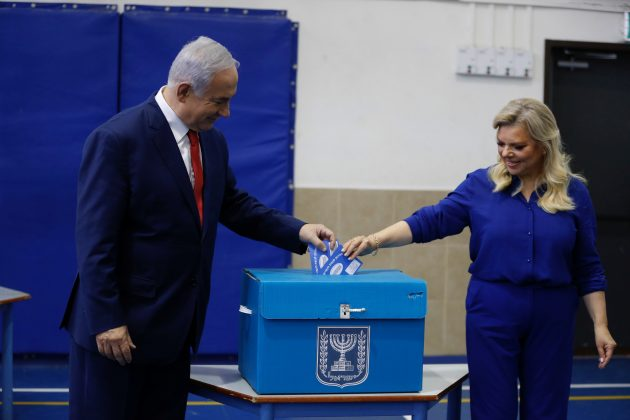 Israel's Prime Minister Benjamin Netanyahu casts his vote with his wife Sara during Israel's parliamentary election in Jerusalem April 9, 2019. Ariel Schalit/Pool via REUTERS