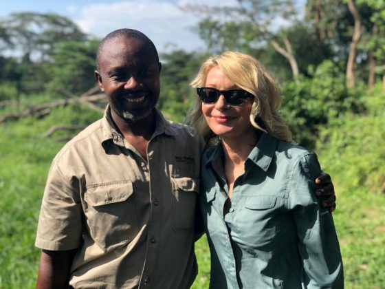 U.S. tourist Kimberly Sue Endicott poses with her guide, Jean Paul Mirenge in Uganda, April 7, 2019, in this image taken from social media. Wild Frontiers/via REUTERS