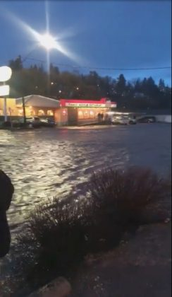 Floodwaters flow along a street in Pullman, Washington, U.S. in this still image taken from April 9, 2019 social media video. ELLIE STENBERG/via REUTERS