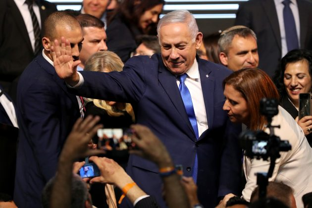 Israeli Prime Minister Benjamin Netanyahu gestures after he speaks following the announcement of exit polls in Israel's parliamentary election at the party headquarters in Tel Aviv, Israel April 10, 2019. REUTERS/Ammar Awad