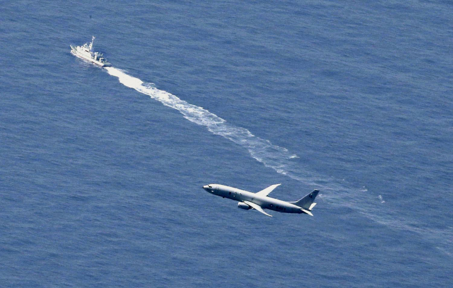 A Japan Coast Guard vessel and a U.S. military aircraft conduct rescue and search operations at the site where an Air Self-Defense Force's F-35A stealth fighter jet crashed during an exercise on April 9, 2019, off Aomori prefecture, Japan, in this photo taken by Kyodo April 10, 2019. Mandatory credit Kyodo/via REUTERS