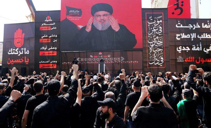 FILE PHOTO: Hezbollah leader Sayyed Hassan Nasrallah addresses supporters via a screen in Beirut, Lebanon, September 20, 2018. REUTERS/Aziz Taher/File Photo