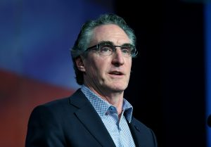 FILE PHOTO:Governor Doug Burgum (R-ND) speaks to delegates at the Republican State Convention in Grand Forks, North Dakota, U.S. April 7, 2018. REUTERS/Dan Koeck
