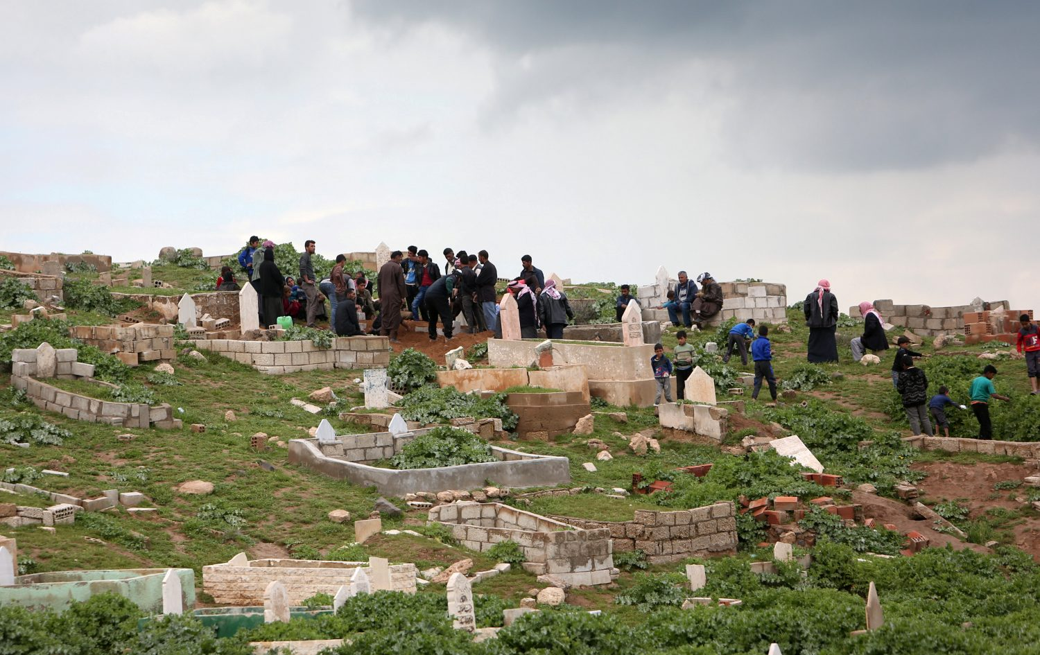 Kurdish people visit a cemetery in Hasaka governorate, Syria April 1, 2019. Picture taken April 1, 2019. REUTERS/Ali Hashisho