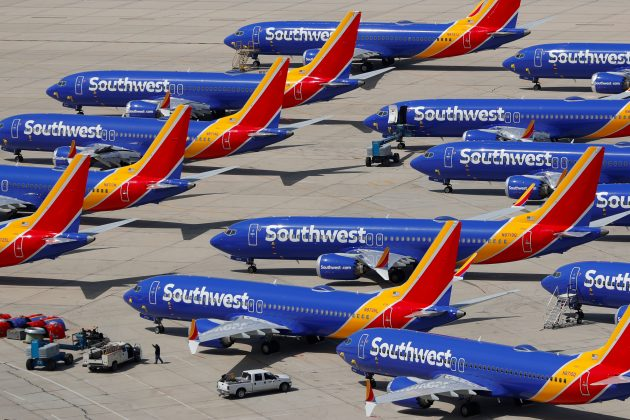 FILE PHOTO: A number of grounded Southwest Airlines Boeing 737 MAX 8 aircraft are shown parked at Victorville Airport in Victorville, California, U.S., March 26, 2019. REUTERS/Mike Blake