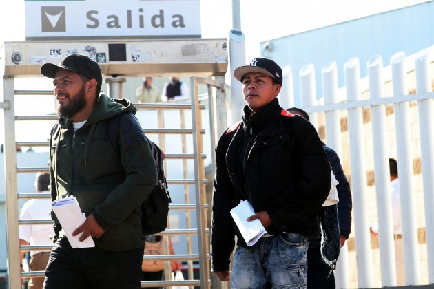 FILE PHOTO: Central American asylum seekers exit the Chaparral border crossing gate after being sent back to Mexico by the U.S. in Tijuana, Mexico, January 30, 2019. REUTERS/Shannon Stapleton/File Photo