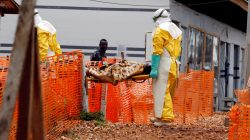 FILE PHOTO: Health workers carry a newly admitted confirmed Ebola patient into a treatment centre in Butembo in the eastern Democratic Republic of Congo, March 28, 2019. REUTERS/Baz Ratner