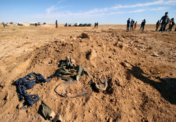 Bits of clothing are seen after they were unearthed from a mass grave of Kurds in west of the city of Samawa, Iraq April 14, 2019. REUTERS/Essam al-Sudani