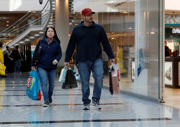 FILE PHOTO: People walk with shopping bags at Roosevelt Field mall in Garden City, New York, U.S., December 7, 2018. REUTERS/Shannon Stapleton