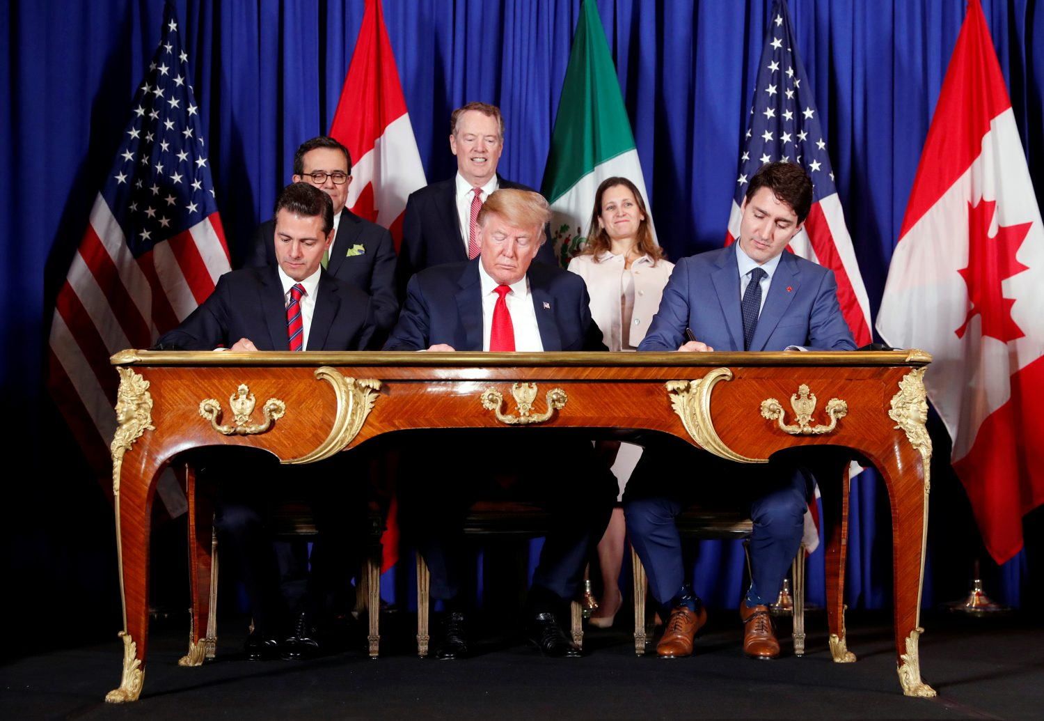 FILE PHOTO: U.S. President Donald Trump, Canada's Prime Minister Justin Trudeau and Mexico's President Enrique Pena Nieto sign documents during the USMCA signing ceremony before the G20 leaders summit in Buenos Aires, Argentina November 30, 2018. REUTERS/Kevin Lamarque/File Photo