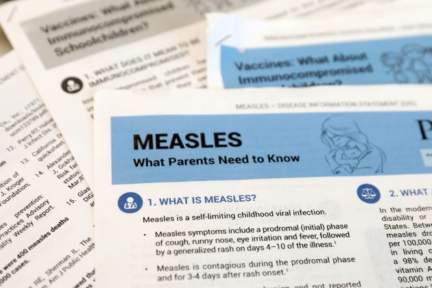 FILE PHOTO: Materials are seen left at demonstration by people opposed to childhood vaccination after officials in Rockland County, a New York City suburb, banned children not vaccinated against measles from public spaces, in West Nyack, New York, U.S. March 28, 2019. REUTERS/Mike Segar/File Photo