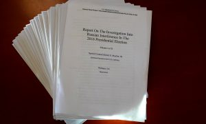 The Mueller Report on the Investigation into Russian Interference in the 2016 Presidential Election is pictured in New York, New York, U.S., April 18, 2019. REUTERS/Carlo Allegri
