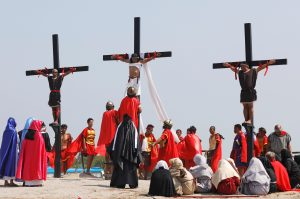 Filipino devotees are nailed on wooden crosses during a crucifixion re-enactment on Good Friday, in San Fernando City, Pampanga province, Philippines, April 19, 2019. REUTERS/Eloisa Lopez
